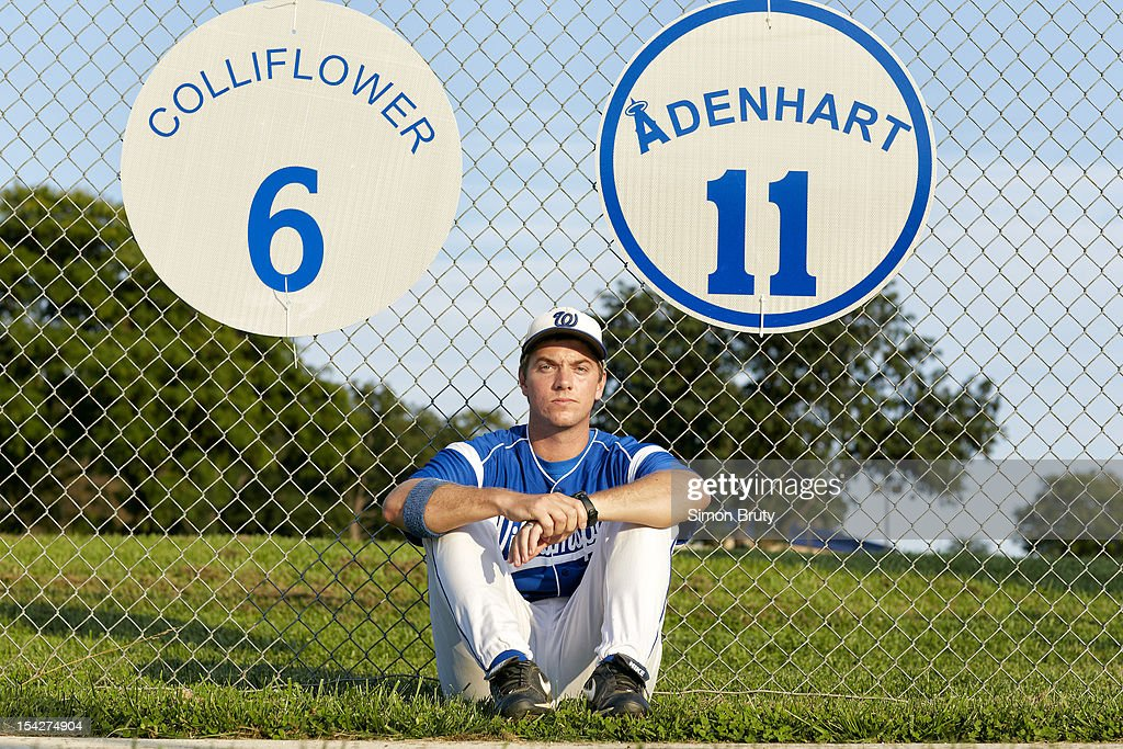 Portrait of Williamsport (MD) High head coach David Warrenfeltz during photo shoot at the school field. View of memorial signs to former Williamsport pitchers Nick Adenhart #11 and Brendon Colliflower #6, both of whom died in separate car crashes. Warrenfeltz coached Colliflower and was Adenhart's teammate. Simon Bruty F89 )