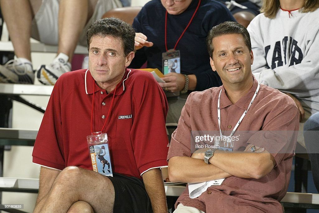 Louisville coach Rick Pitino (L) and Memphis coach John Calipari (R) in stands at National Institute for Fitness and Sport. Indianapolis, IN 7/8/2002