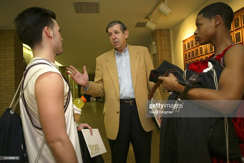 HSBI Report editor and publisher Tom Konchalski scouts unsigned players after game at Rose Hill Gym on Fordham University campus. Bronx, NY 3/12/2003