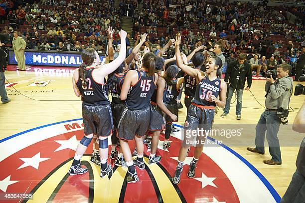 McDonald's All American Game Team West Jamie Nared victorious with teammates after winning game vs Team East during Girl's game at United Center...