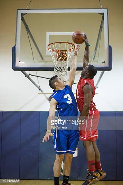 High school basketball player dunking