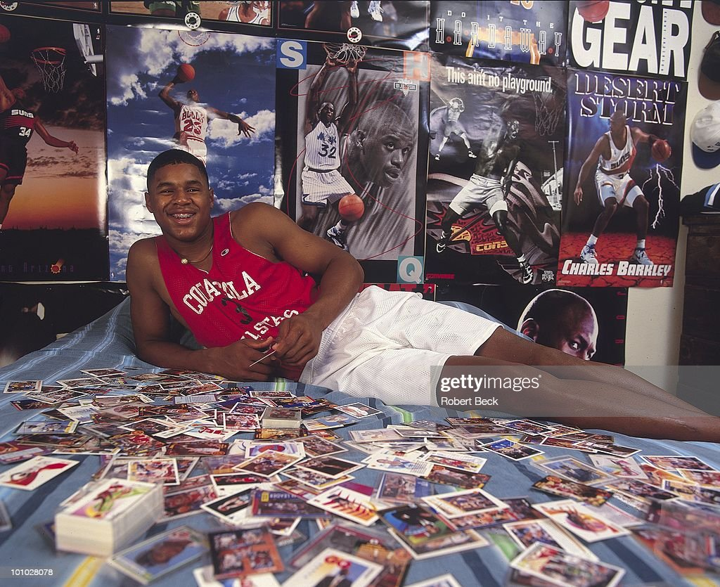 Portrait of Mater Dei HS Schea Cotton (13) during photo shoot with baseball cards at home. Huntington Beach, CA 7/13/1994