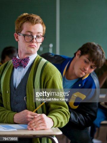 High School Boy Jock Cheating Off A High School Nerd Stock ...