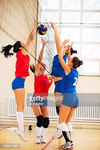 High school female volleyball team in action.