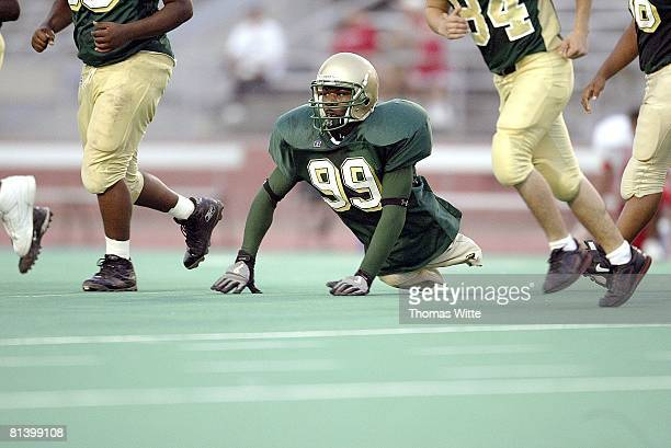 High School Football Colonel White HS Bobby Martin in action chasing punt returner vs Belmont High Dayton OH 9/24/2005
