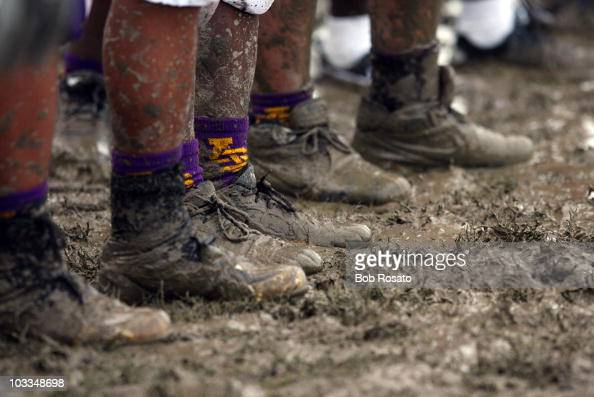 Hurricane Katrina View of St Augustine High School Purple Knights varsity football team cleats in mud during game Equipment New Orleans LA 8/26/2006...