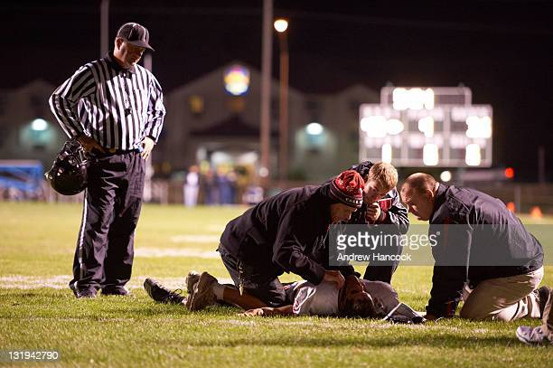 Lafayette Jefferson senior Hunter Elser suffered concussion during game vs Westfield High at Westfield Middle School Elser is examined by athletic...