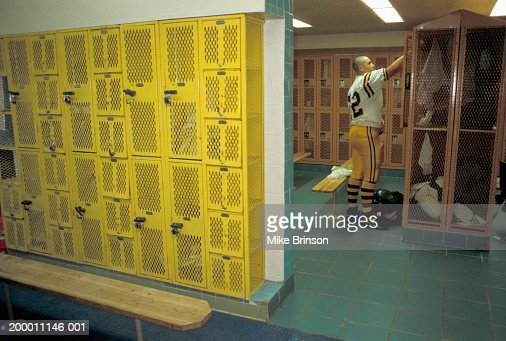 high school football player standing in locker room photo getty images. Black Bedroom Furniture Sets. Home Design Ideas
