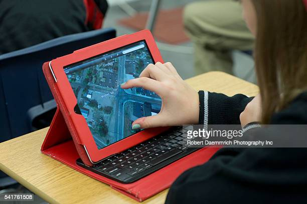 High school freshmen and sophomore students at Concordia High School using Apple iPads in the world geography classroom at the private religious...