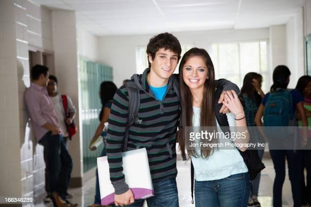 High school friends standing in corridor together