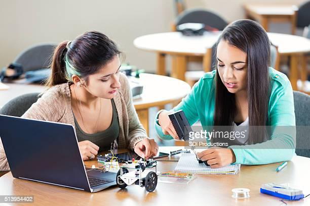 High school friends working on robotics assignment