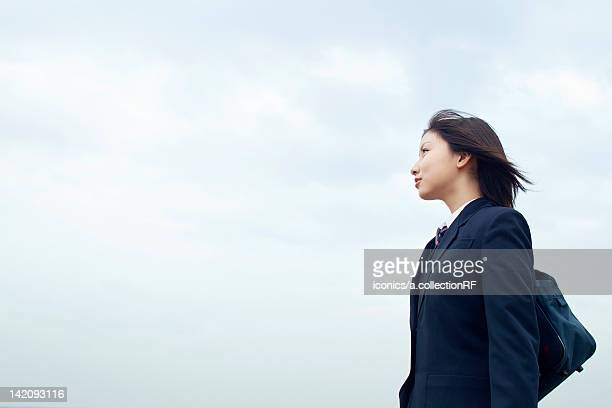 High school girl against sky