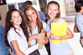 High school girl friends in uniforms