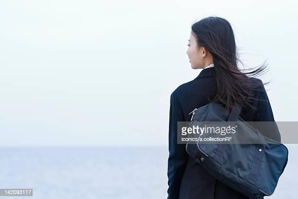 High school girl looking at the ocean