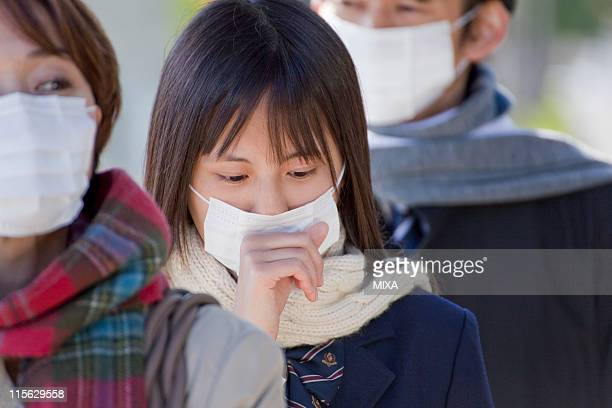 High School Girl with Mask Standing and Coughing