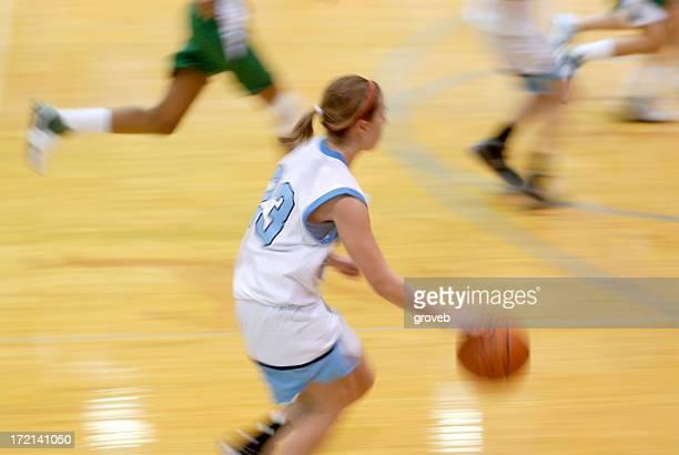High school girls basketball action