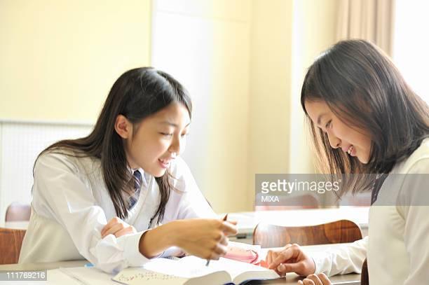 High School Girls Talking in Classroom