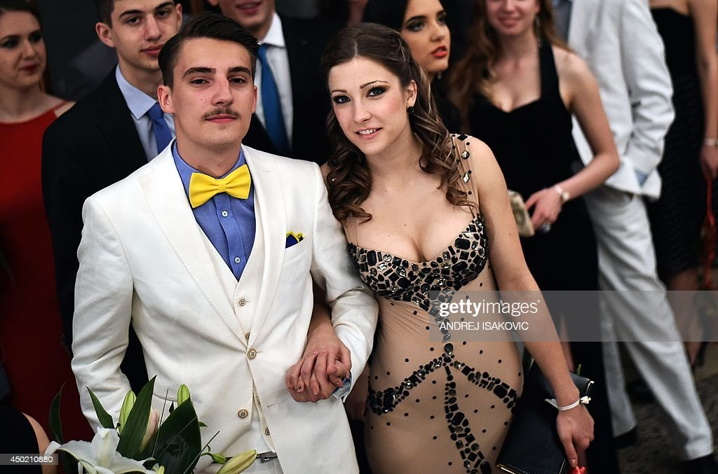 High school graduates arrive to their prom night in the Serbian capital of Belgrade on June 6, 2014.