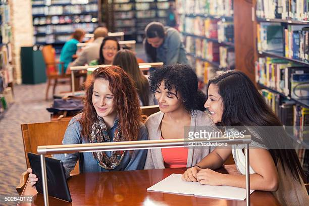 High school or college students take selfie in libary