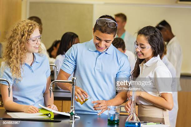 High school science students doing experiment in chemistry class