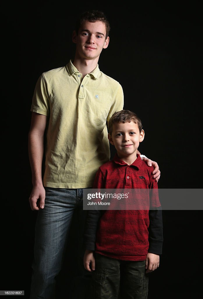 High school senior Denis Dikarev, 17, stands with his third grade brother Timothy Dikarev, 8, while they wait for their citizenship certificates at the U.S. Citizenship and Immigration Services (USCIS), office on February 19, 2013 in New York City. The brothers were born in Russia and their father, Alexy Dikarev, a naturalized American from Russia, is a maintenance worker. The family lives in Brooklyn, New York. Almost 300 foreign-born children of naturalized Americans received citizenship certificates Tuesday at the USCIS center during the special event. Children of naturalized immigrants receive U.S. citizenship if they arrive to the United States as minors, but they must go through a process at USCIS to receive official citizenship documents proving they have become Americans.