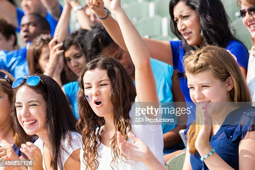 High school sports fans cheering for team in stadium