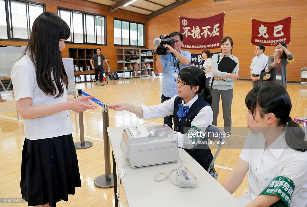 A high school student aged 18 receives a ballot paper at an early polling station set at Kashihara High School on June 27, 2016 in Kashihara, Nara, Japan. From the Upper House election, taking place on July 10, the age of voters lowers to 18.