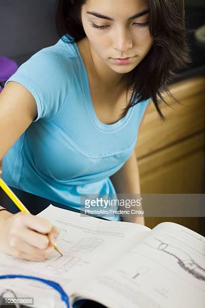 High school student doing classwork