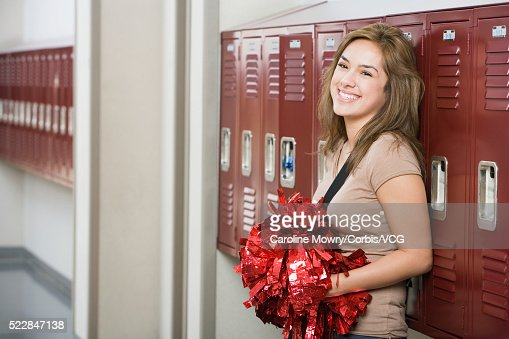 high school student holding pompoms photo getty images. Black Bedroom Furniture Sets. Home Design Ideas