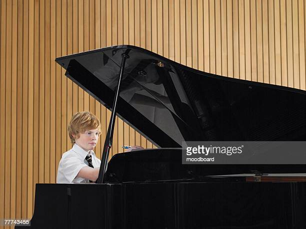 High School Student Practicing Piano