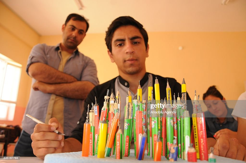High school student Ramazan Balay, sculpts pencil graphites by using scalpel and create different shapes in Turkey's Mardin district on May 28, 2016.