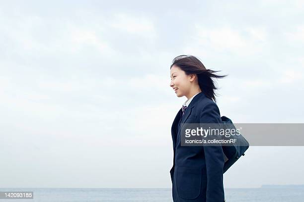 High School Student Standing by Sea