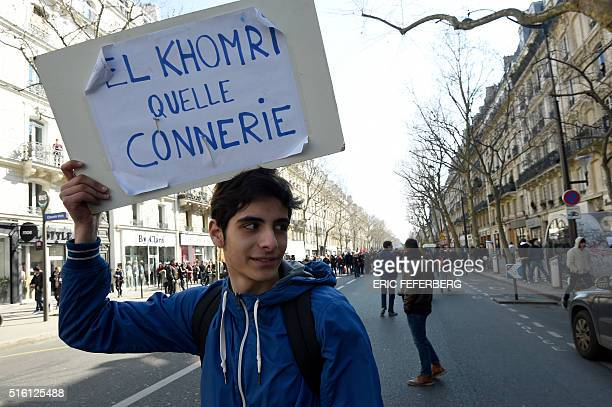 A high school student takes part in a march opposing the government's planned Labour reform bill on March 17 2016 in Paris The placard reads ' El...