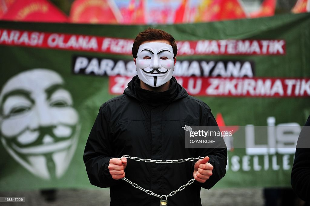 A high school student wears a <a gi-track='captionPersonalityLinkClicked' href=/galleries/search?phrase=Guy+Fawkes&family=editorial&specificpeople=101029 ng-click='$event.stopPropagation()'>Guy Fawkes</a> mask and holds a locked chain during a demostration in Istanbul on February 13,2015. A boycott of schools was launched on Feb. 13 upon a call from the teachers union and a number of Alevi associations to protest the governments recent education system implementations, including on compulsory religion classes.