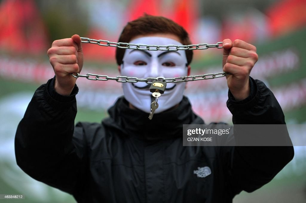A high school student wears a Guy Fawkes mask and holds a locked chain during a demostration in Istanbul on February 13,2015. A boycott of schools was launched on Feb. 13 upon a call from the teachers union and a number of Alevi associations to protest the governments recent education system implementations, including on compulsory religion classes.
