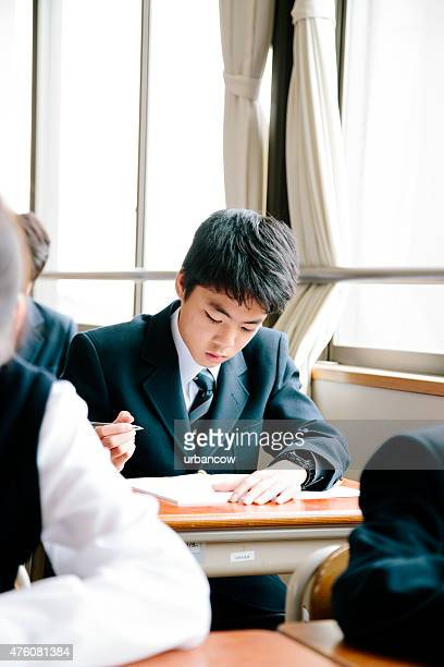 High school student, young male student working in classroom, Japan