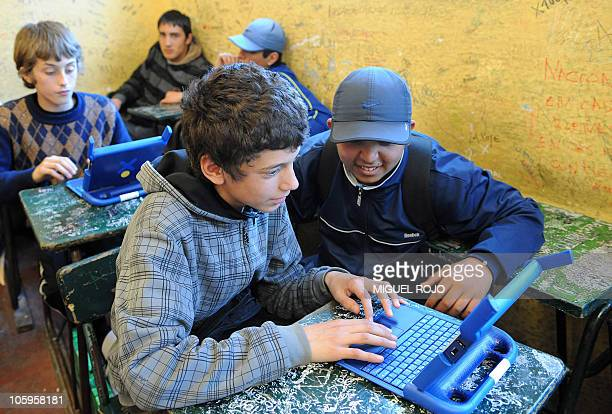 High school students at an education centre in Montevideo use their new computers given on October 18 2010 by civil servants in the framework of the...