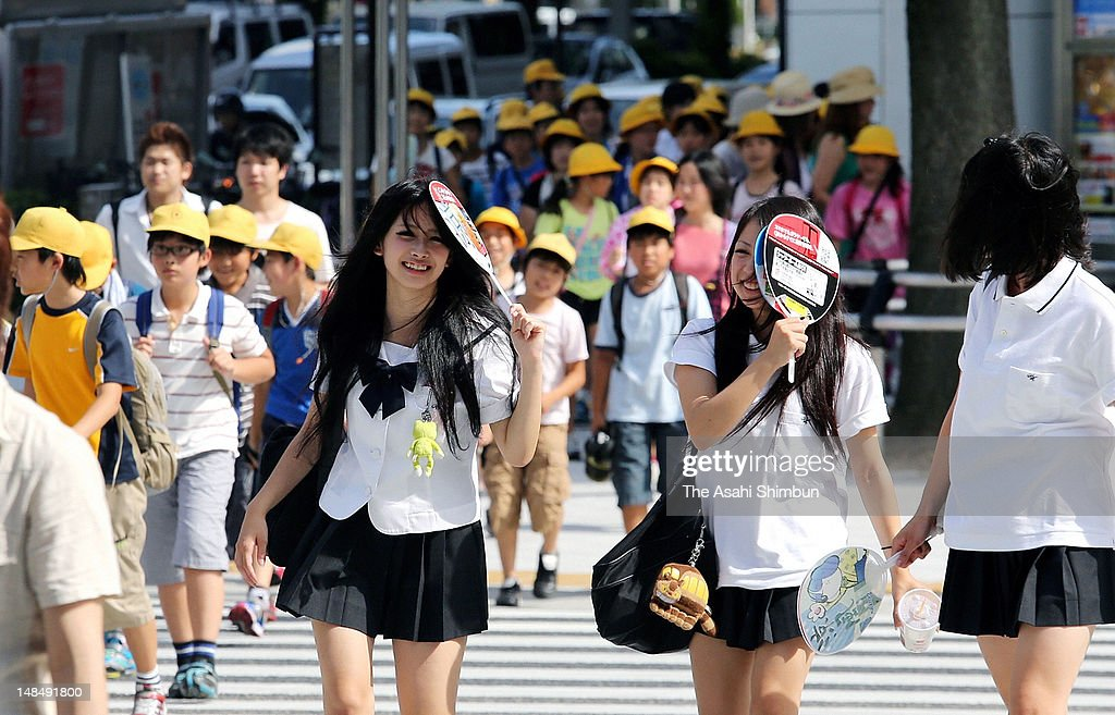 High school students avoid the direct sunlight with fans on July 17, 2012 in Nagoya, Aichi, Japan. Japan Meteorological Agency announced that the rainy season seems finish in most of the area in Japan.