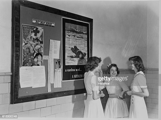 High School students gathered in entrance hall near a bulletin board Keysville Virginia June 1943 | Location Keysville Virginia USA