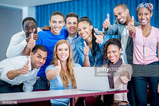 High School Students Giving Thumbs up in Class