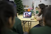High school students in Harlem New York City watch a video of serving and former US military soldiers December 14 2011 who explain how their military...