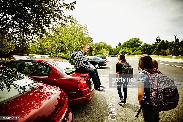 High school students in parking lot after school