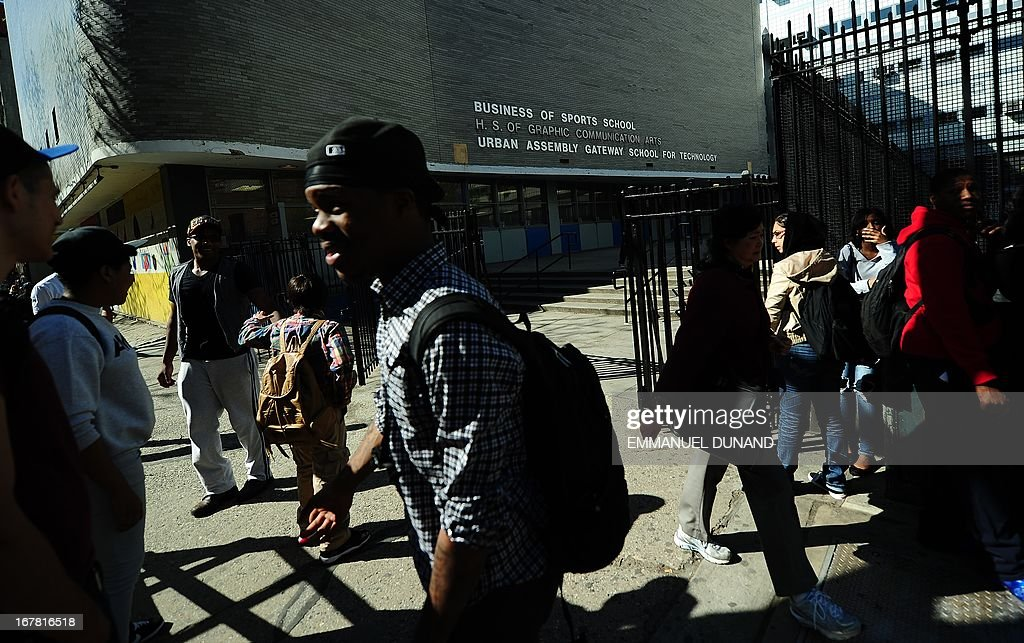 High school students leave the High School of Graphic Communication Arts in New York on April, 30, 2013. New York City Mayor Michael Bloomberg announced education officials will cut the ribbon on 78 new city schools in September, bringing the number of public schools opened during the Bloomberg administration to 656. AFP PHOTO/Emmanuel Dunand