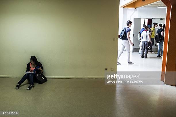 High school students look for their classroom as another does a lastminute revsision prior to pass the philosophy exam the first test session of the...