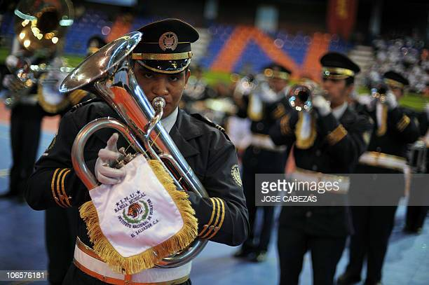 High school students perform during a marching band festival in San Salvador El Salvador on November 5 2010 AFP PHOTO/Jose Cabezas