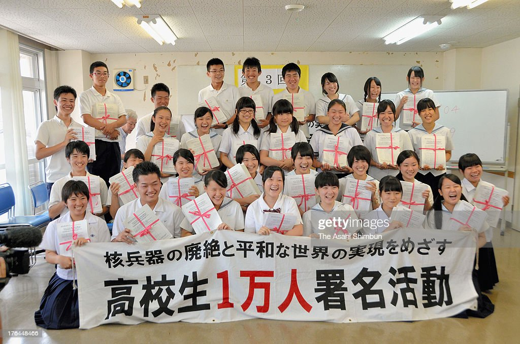 High school students pose for a photograph as Executive Comitee of High School Student 10000 Petitions has collected more than one million personally signed petitions for total abolition of nuclear weapons and world peace on August 12, 2013 in Nagasaki, Japan. The Executive Comitee of High School Student 10000 Petitions, a Japanese civil activist group organized by and for high school students in 2001, has collected signed petitions from 13 countries, and 20 of the ambassadors will visit the U.N. headquarters in Geneva, Swizerland to submit the petitions on August 20, 2013.