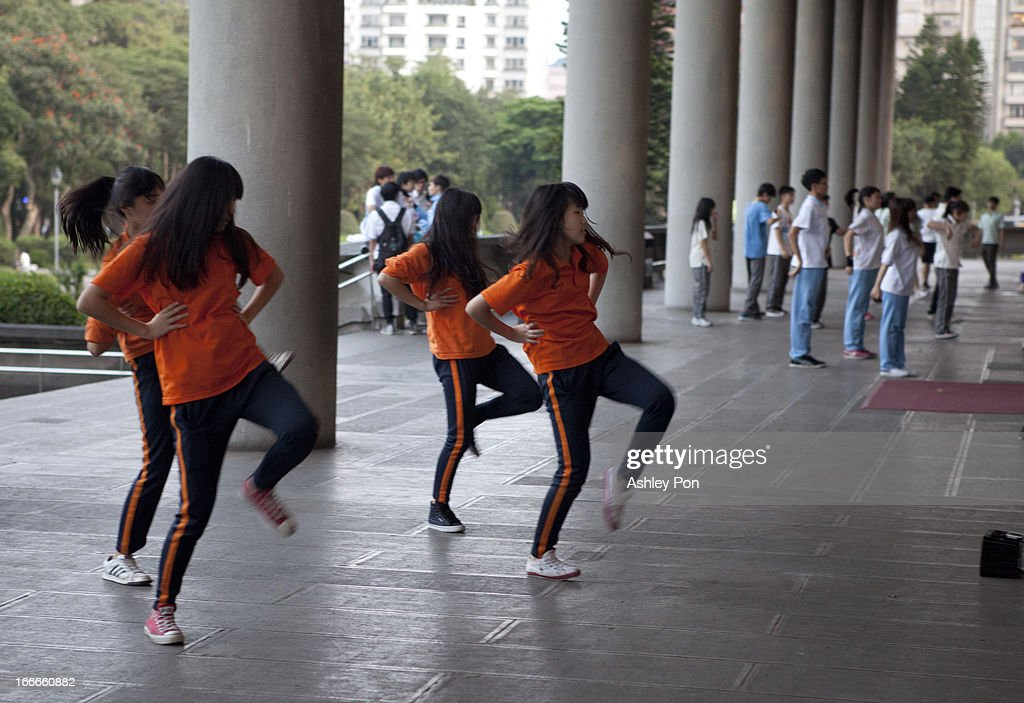High school students practice dance moves in Dr. Sun Yet-sen Memorial Hall on April 15, 2013 in Taipei, Taiwan.