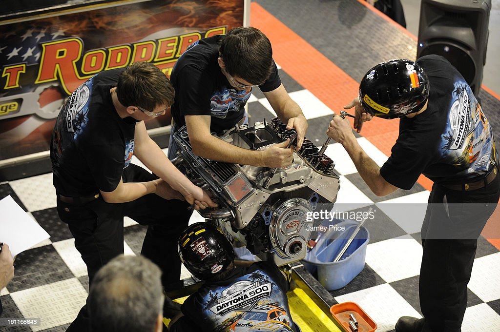 High school students rebuild an engine in a competition at the NASCAR Hall of Fame on Saturday morning February 9, 2013 in Charlotte, North Carolina.