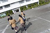 High School Students Running on School Ground