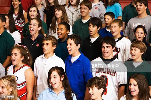High School Students Singing in Bleachers